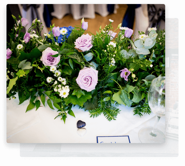 wedding florist hampshire providing purple wedding flowers for a ceremony.